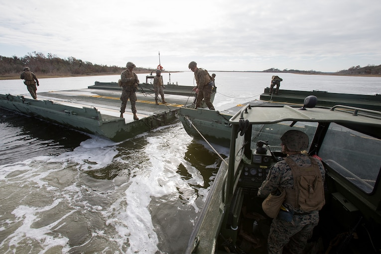 Marines construct a floating bridge system