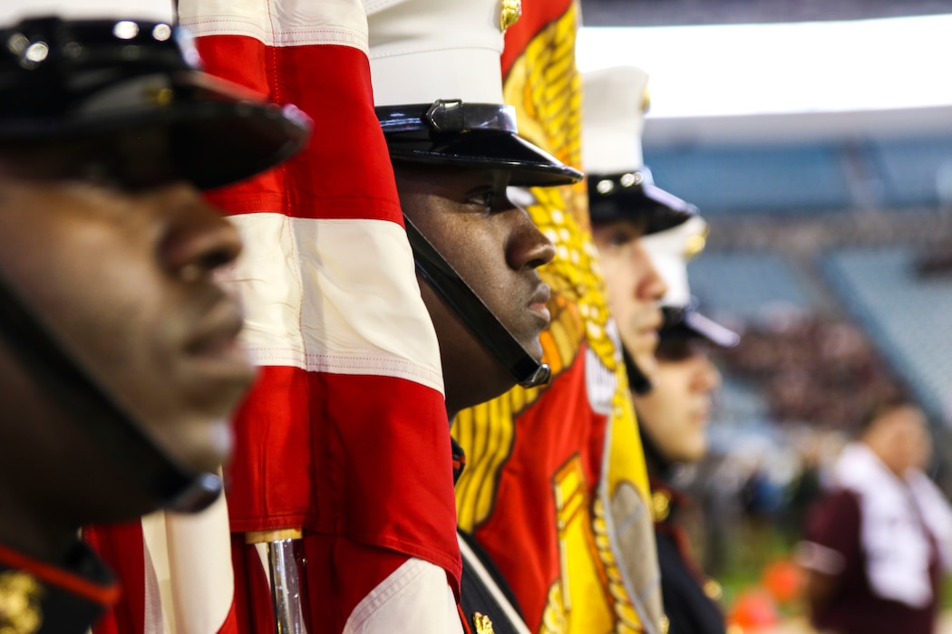 Recruiting Station Jacksonville's color guard stages for the National Anthem during the pre-game show of TaxSlayer Gator Bowl, Dec. 31, 2018, at TIAA Bank Field in Jacksonville, Florida. The Parris Island Marine Band performed the National Anthem for the fans of Texas A&M University and North Carolina State University. (U.S. Marine Corps Photo by Cpl. Mike Hernandez)