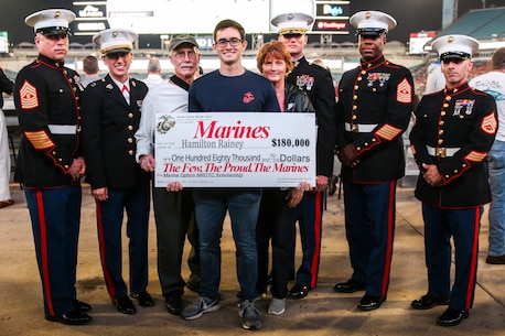 Hamilton Rainey, a poolee with Recruiting Substation Yulee, Recruiting Station Jacksonville, is presented a Navy Reserves Officer Training Corps Scholarship at TaxSlayer Gator Bowl, Dec. 31, 2018, at TIAA Bank Field in Jacksonville, Florida. Rainey was selected among four other applicants in RS Jacksonville's area of operation. (U.S. Marine Corps Photo by Cpl. Mike Hernandez)
