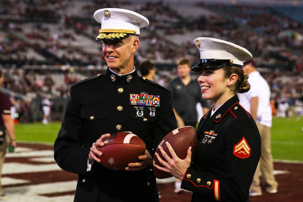 Brig. Gen. James F. Glynn, commanding general of Marine Corps Recruit Depot Parris Island and the Eastern Recruiting Region, holds one of the game footballs beside Cpl. Eliyanna Heilig, a canvassing recruiter with Recruiting Substation Ponte Vedra, Recruiting Station Jacksonville, at TaxSlayer Gator Bowl, Dec. 31, 2018, at TIAA Bank Field in Jacksonville, Florida. Glynn was invited by the Jacksonville Sports Council to be the guest-of-honor during the game. (U.S. Marine Corps Photo by Cpl. Mike Hernandez)