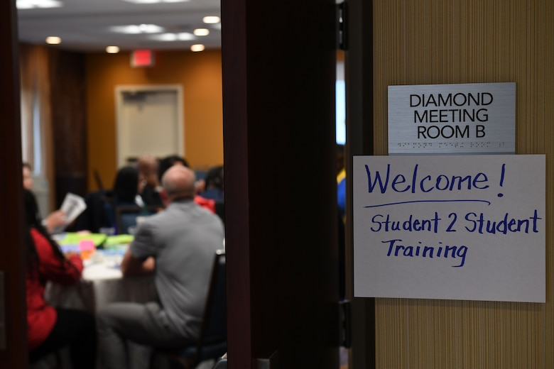 A sign on a dorr says welcome to Student 2 Student training.