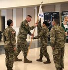 Guidon hand-off at the Change of Command ceremony for Columbus Medical Recruiting Company