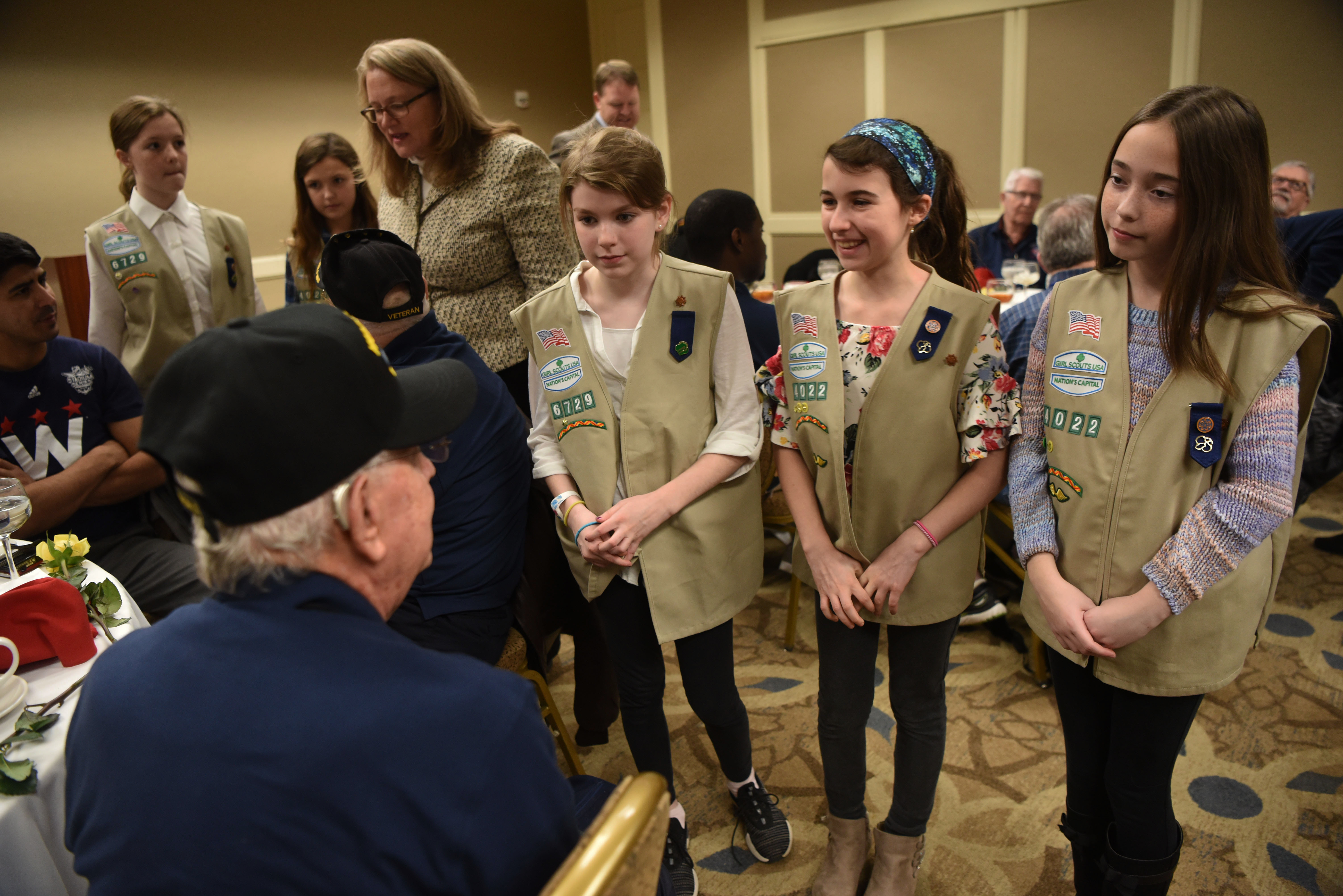 veteran with girl scouts