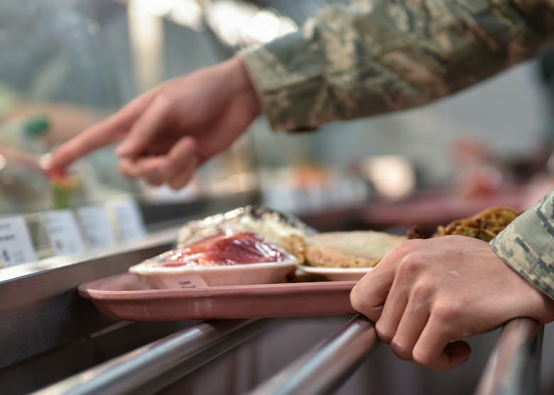 A patron of Thunderbird Inn points to his entree selection at Kirtland Air Force Base, N.M., Jan. 22, 2019. The Hennessy Award Program recognizes exceptional food service support within the Air Force. (U.S. Air Force photo by Airman 1st Class Austin J. Prisbrey)