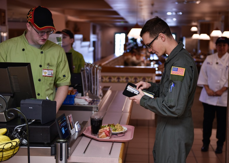 A patron of Thunderbird Inn pays for his lunch at Kirtland Air Force Base, N.M., Jan. 22, 2019. The Hennessy Travelers will evaluate two more dining facilities and then determine an overall winner for the Hennessy Award in the western region. (U.S. Air Force photo by Airman 1st Class Austin J. Prisbrey)