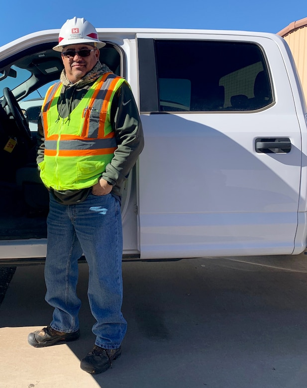 Richard Martinez, the District's Field Employee of the Year, stands next to his truck before heading out on a site visit, Jan. 3, 2019.