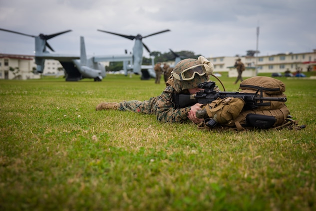 Lance Cpl. Amber M. Laflamme provides security during helicopter support team training at Camp Foster, Okinawa, Japan, Jan. 14, 2019. Landing Support Company, 3rd Transportation Support Battalion, Combat Logistics Regiment 3, 3rd Marine Logistics Group supported Marine Medium Tiltrotor Squadron 265, Marine Aircraft Group 36, 1st Marine Aircraft Wing during external lift training, which ensures pilots and landing support specialists are able to communicate as well as transport gear from one location to another. Laflamme, a landing support specialist, is a native of Rutland, Vermont. (U.S. Marine Corps Photo by Cpl. André T. Peterson Jr.)