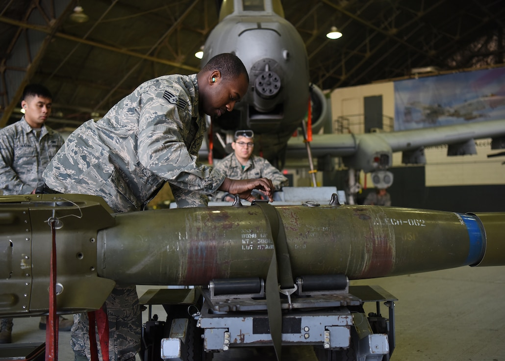 U.S. Air Force Staff Sgt. Ja Mouri Moye, a weapons load crew chief assigned to the 51st Aircraft Maintenance Squadron, inspects munitions during a quarterly load crew competition at Osan Air Base, Republic of Korea, Jan. 11, 2019. Weapons load crew team members were tested on their speed and accuracy while loading munitions onto an A-10 Thunderbolt II. (U.S. Air Force photo by Sergio A. Gamboa)