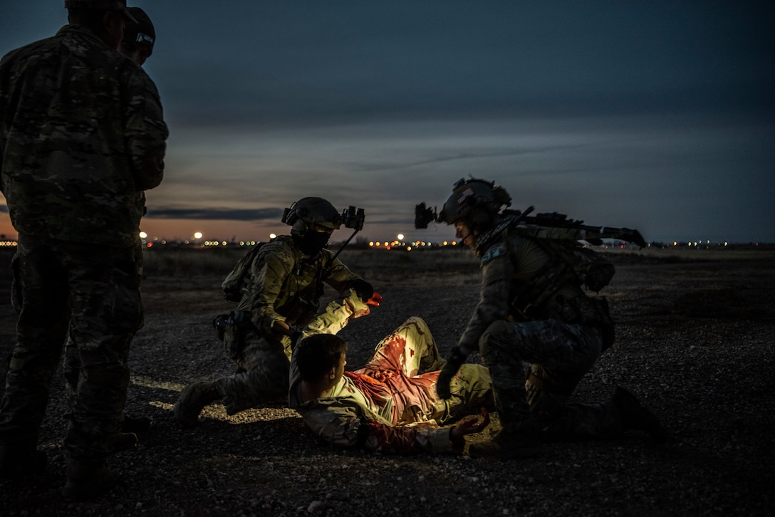 Security Forces Airmen from the 27th Special Operations Security Forces Squadron prepare to move a wounded Soldier to a safe location during a mass casualty exercise at Cannon Air Force Base, N.M., Jan. 14, 2019. The 27th SOSFS participated in a mass casualty exercise with medical personnel to train on clearing hostile locations, while escorting wounded Soldiers to safety. (U.S. Air Force photo by Airman 1st Class Gage Daniel)