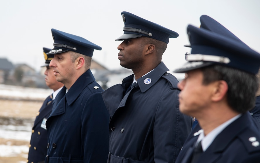 U.S. Air Force Lt. Col. David Dammeier, left, the 35th Civil Engineer Squadron commander, and Master Sgt. Damean Moore, a 35th CES fire chief, walk side-by-side during the annual Misawa City Fire Department New Year ceremony at Misawa City, Japan, Jan. 20, 2019. Team Misawa's fire department units joined together to celebrate the New Year through a short fire demonstration, a parade and speeches, wishing all firefighters and their supporters a successful and prosperous year. During the events, local community members gathered to cheer on the dispatch teams. (U.S. Air Force photo by Senior Airman Sadie Colbert)