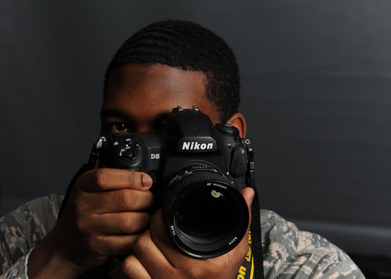 Airman 1st Class Octavius Thompson, 39th Air Base Wing photojournalist, prepares to take a photo at Incirlik Air Base, Turkey, Jan. 17, 2019. As a photojournalist, Thompson crafted visual stories representing how Airmen at Incirlik maintain the mission and advance themselves. (U.S. Air Force photo by Senior Airman Kirby Turbak)