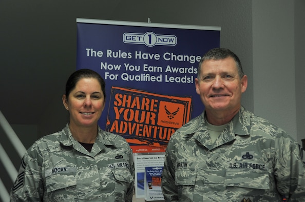 SMSgts Dominque Hogan, 403rd Wing senior recruiter and Paul Martin, 403rd Wing Inspector General Inspector superintendent pose in front of the Get1Now program sign.  Martin has submitted multiple names into the Get1Now program in order to recruit new Airmen for the Air Force Reserve.  (U.S. Air Force photo by Jessica L. Kendziorek)