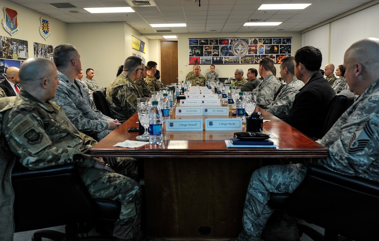 Maj. Gen. John Gordy, U.S. Air Force Expeditionary Center commander, and Chief Master Sgt. Kristopher Berg, USAF EC command chief, sit in on a base mission brief Jan. 17, 2019, at Joint Base Charleston, S.C.