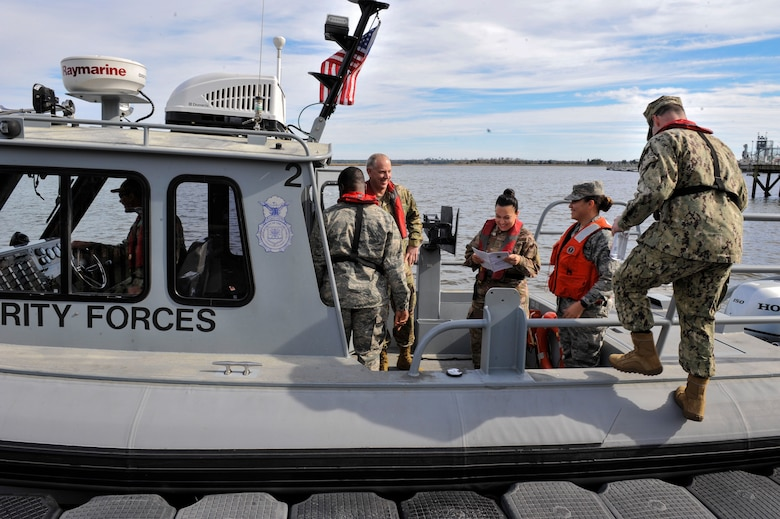 U.S. Air Force Expeditionary Center leadership boards a 27-foot SeaArk for a harbor security patrol boat tour Jan. 17, 2019, at Joint Base Charleston, S.C.