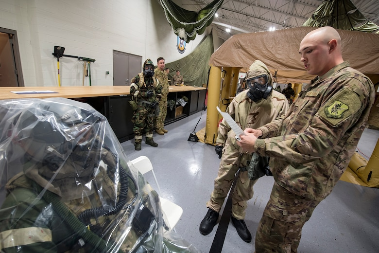 Airman First Class Gary Scott, right, 347th Operations Support Squadron (OSS) Aircrew Flight Equipment apprentice, breifs Col. Jennifer Short, 23d Wing commander, prior to a simulated lightweight inflatable decontamination walk, January 14, 2019, at Moody Air Force Base, Ga. Scott was recognized by Team Moody's leadership for his exceptional performance as an Airman.