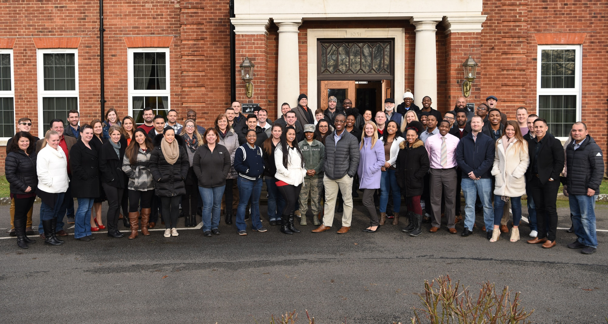 A U.S. Air Force Master Resilience Trainer class poses for a photo at RAF Mildenhall, England, Jan. 18, 2019. Participants from around U.S. Air Forces in Europe Air Forces Africa were taught briefing and presentation skills, how resilience can be applied both at work and home, and how it can enhance mission accomplishment. (U.S. Air Force photo by Airman 1st Class Brandon Esau)