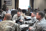 military members listen to briefings