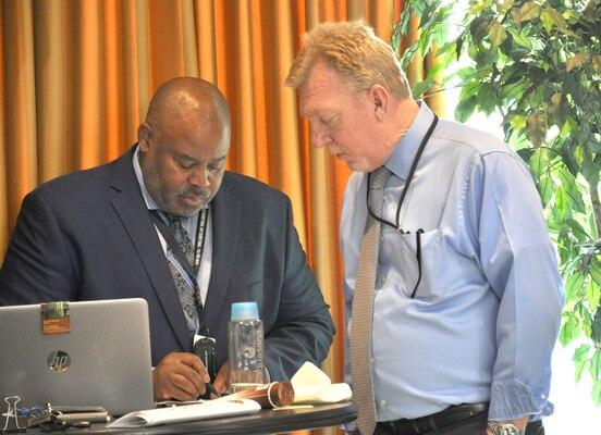 two men look at paper