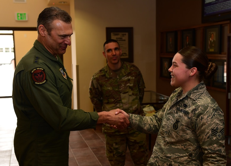 U.S. Air Force Lt. Gen. Joseph Guastella, U.S. Air Forces Central Command commander, speaks with a top performer at Creech Air Force Base, Nevada, Jan. 16, 2019. Guastella coined several 432nd Wing/432nd Expeditionary Wing and 799th Air Base Group outstanding Airmen. (U.S. Air Force photo by Senior Airman Christian Clausen)