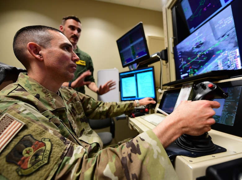 U.S. Air Force Chief Master Sgt. Shawn Drinkard, U.S. Air Forces Central Command command chief, pilots a simulated Reaper in a flight simulator, at Creech Air Force Base, Nevada, Jan. 16, 2019. These simulators ensure Reaper pilots and sensor operators remain current with flight training and utilize skills in realistic combat situations. (U.S. Air Force photo by Senior Airman Christian Clausen)