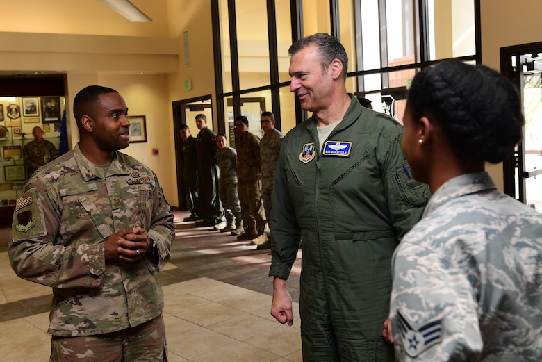 U.S. Air Force Lt. Gen. Joseph Guastella, U.S. Air Forces Central Command commander, speaks with a top performer's supervisor at Creech Air Force Base, Nevada, Jan. 16, 2019. Guastella coined several 432nd Wing/432nd Expeditionary Wing and 799th Air Base Group outstanding Airmen who deliver persistent attack and reconnaissance against the nation's enemies. (U.S. Air Force photo by Senior Airman Christian Clausen)