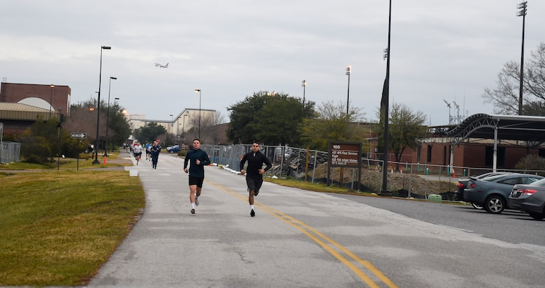Senior Airman Will Merriman (left), 315th Force Support Squadron knowledge management specialist, and Senior Airman Alberto Castillo (right), 437th Maintenance Squadron crew chief, lead the pack of runners Jan. 18, 2019, during the Martin Luther Jr. 5k run at Joint Base Charleston, S.C.