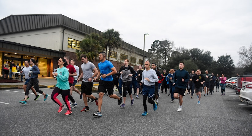Team Charleston members take off from the starting line at the air base fitness center Jan. 18, 2019, during the annual Martin Luther King Jr. 5K run.
