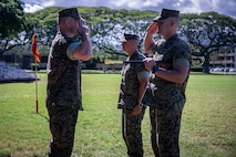 U.S. Marine Corps Sgt. Maj. Kenneth Kuss, off-going sergeant major, Combat Logistics Battalion (CLB) 3, salutes Lt. Col. Paul Goguen, commanding officer, CLB-3, during the CLB-3 Relief and Appointment Ceremony, Marine Corps Base Hawaii, Jan. 17, 2019. Sgt. Maj. Kuss relinquished responsibilities to Sgt. Maj. John Maciel. (U.S. Marine Corps photo by Cpl. Matthew Kirk)