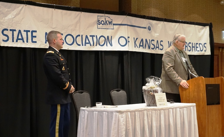 The State Association of Kansas Watersheds held their 68th Annual Meeting in Topeka Jan. 22, 2019. which brought together the many water district representatives and some of their largest partners in federal, state and local government. Col. Doug Guttormsen, the Kansas City District commander, served as the keynote speaker. Jeremiah Hobbs, vice-president of SAKW, to the right provided the introduction.