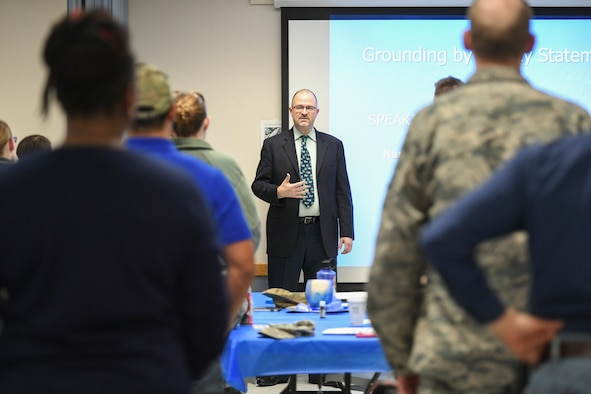 Judge Robert R. Lung demonstrates grounding techniques to cope with trauma during the combating trafficking in persons event Jan. 17, 2019, at Hill Air Force Base, Utah. Lung is the 18th District Judge in Douglas County, Colorado, and was appointed by the president to serve on the U.S. Advisory Council on Human Trafficking. (U.S. Air Force photo by Cynthia Griggs)