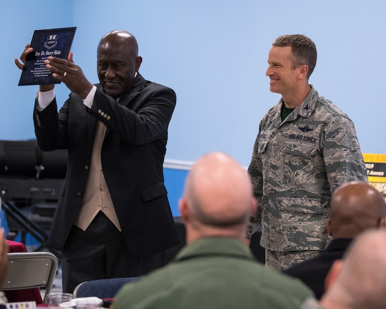 Col. Rob Makros, 2nd Bomb Wing vice commander, thanks Rev. Dr. Harry Blake, local civil rights pioneer, for his time and dedication with a plaque at Barksdale Air Force Base, La., Jan. 18, 2019. Blake served as the first field secretary of the Southern Christian Leadership Conference under the guidance of Martin Luther King Jr. (U.S. Air Force photo by Airman 1st Class Lillian Miller)