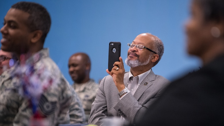 An audience member smiles while recording a speech given by local civil rights pioneer, Rev. Dr. Harry Blake at Barksdale Air Force Base, La., Jan. 18, 2019. Blake served with Martin Luther King Jr. in the Southern Christian Leadership Conference. (U.S. Air Force photo by Airman 1st Class Lillian Miller)