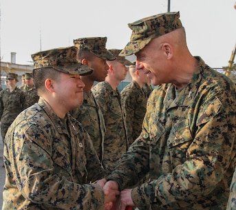 CAMP HUMPHREYS, Republic of Korea – Capt. Inchul Ha, U.S. Marine Corps Forces Korea logistics planner, receives the Navy and Marine Corps Achievement Medal from Maj. Gen. Patrick J. Hermesmann, MARFORK commander, here, Jan. 22. Ha helped orient and align the command's logistics focus to set the force for all Marines Corps forces in Korea. (Official U.S. Marine Corps photos by Sgt. Nathaniel Hanscom/Released)