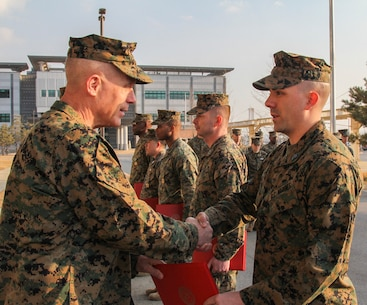 CAMP HUMPHREYS, Republic of Korea – Sgt. Craig Richie, U.S. Marine Corps Forces Korea G-6 help desk chief, receives a Certificate of Commendation from Maj. Gen. Patrick J. Hermesmann, MARFORK commander, here, Jan. 22. Richie earned MARFORK Non-Commissioned Officer of the Quarter for his professional example and contribution to the unit's mission accomplishment. (Official U.S. Marine Corps photos by Sgt. Nathaniel Hanscom/Released)