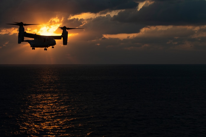 An MV-22B Osprey tiltrotor aircraft belonging to Marine Medium Tiltrotor Squadron 262 approaches the amphibious assault ship USS Wasp during flight operations underway in the Philippine Sea, Jan. 23, 2019. Naval aviators with VMM-262, the tiltrotor component of the 31st Marine Expeditionary Unit's Aviation Combat Element, perform a wide variety of aviation missions for the 31st MEU, including troop transport, heavy and medium lift, fixed-wing attack support and aerial reconnaissance. The 31st MEU, the Marine Corps' only continuously forward-deployed MEU partnering with the Wasp Amphibious Ready Group, provides a flexible and lethal force ready to perform a wide range of military operations as the premier crisis response force in the Indo-Pacific region.