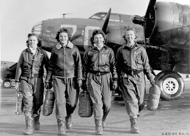A historic photo of four members of WASP