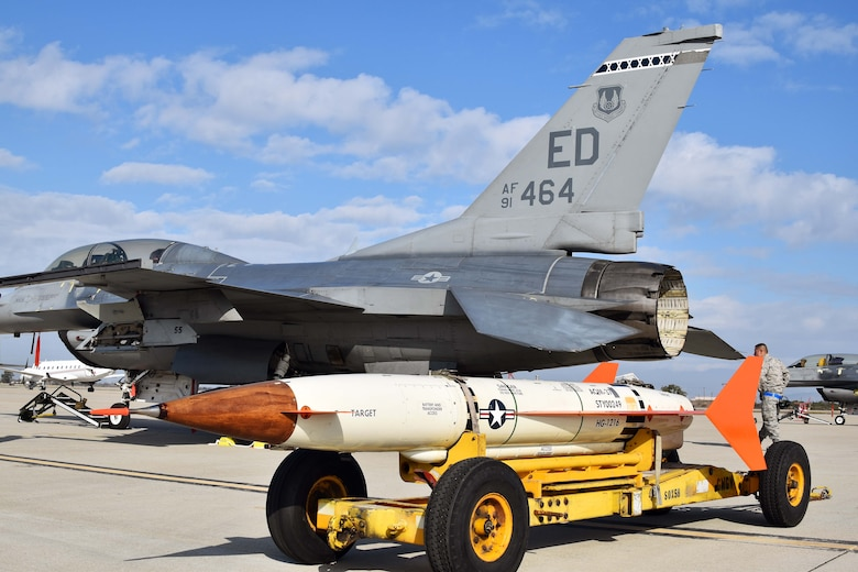 An Edwards Air Force Base F-16 sits at Naval Air Station Point Mugu, California, along with an AQM-37D supersonic target, Nov. 28, 2018. Two F-16s and maintenance Airmen from Edwards assisted the U.S. Navy and Royal Australian Navy with a test of a RAN ship's combat system late last year. (U.S. Navy photo by BU3 Dakota Fink)