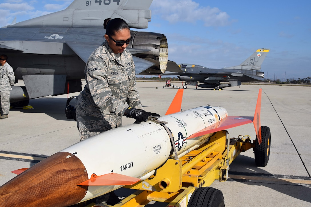 Airman 1st Class Cierra-Mae Hanson, 412th Maintenance Group, inspects an AQM-37D supersonic target before it is loaded on to an Edwards Air Force Base F-16 at Naval Air Station Point Mugu, California, Nov. 28, 2018. Two F-16s, a KC-135 Stratotanker, and maintenance Airmen from Edwards assisted the U.S. Navy and Royal Australian Navy with a test of a Royal Australian Navy ship's combat system late last year. (U.S. Navy photo by BU3 Dakota Fink)