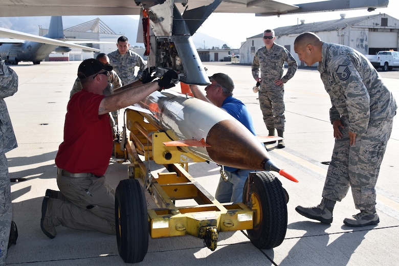 Airmen from the 412th Maintenance Group are assisted by members of the Naval Air Warfare Center Weapons Division's Threat/Targets Department at Naval Air Station Point Mugu, California. They are loading an AQM-37D supersonic target, Nov. 28, 2018. Two F-16s, a KC-135 Stratotanker, and maintenance Airmen from Edwards assisted the U.S. Navy and Royal Australian Navy with a test of a Royal Australian Navy ship's combat system late last year. The Point Mugu team consisted of Lee Cobb, Tad Miller and Jeremy Gibson. (U.S. Navy photo by BU3 Dakota Fink)