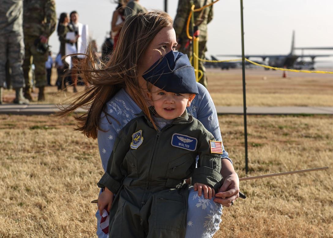 317th AW Airmen return home, embrace their families
