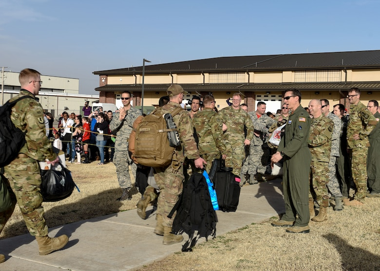317th AW Airmen return home, embrace their families
