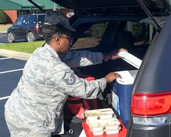 Smith has been delivering free meals to vulnerable members of the community as part of a meals-on-wheels program for more than 10 years. (U.S. Air Force photo by Jeramy Moore)