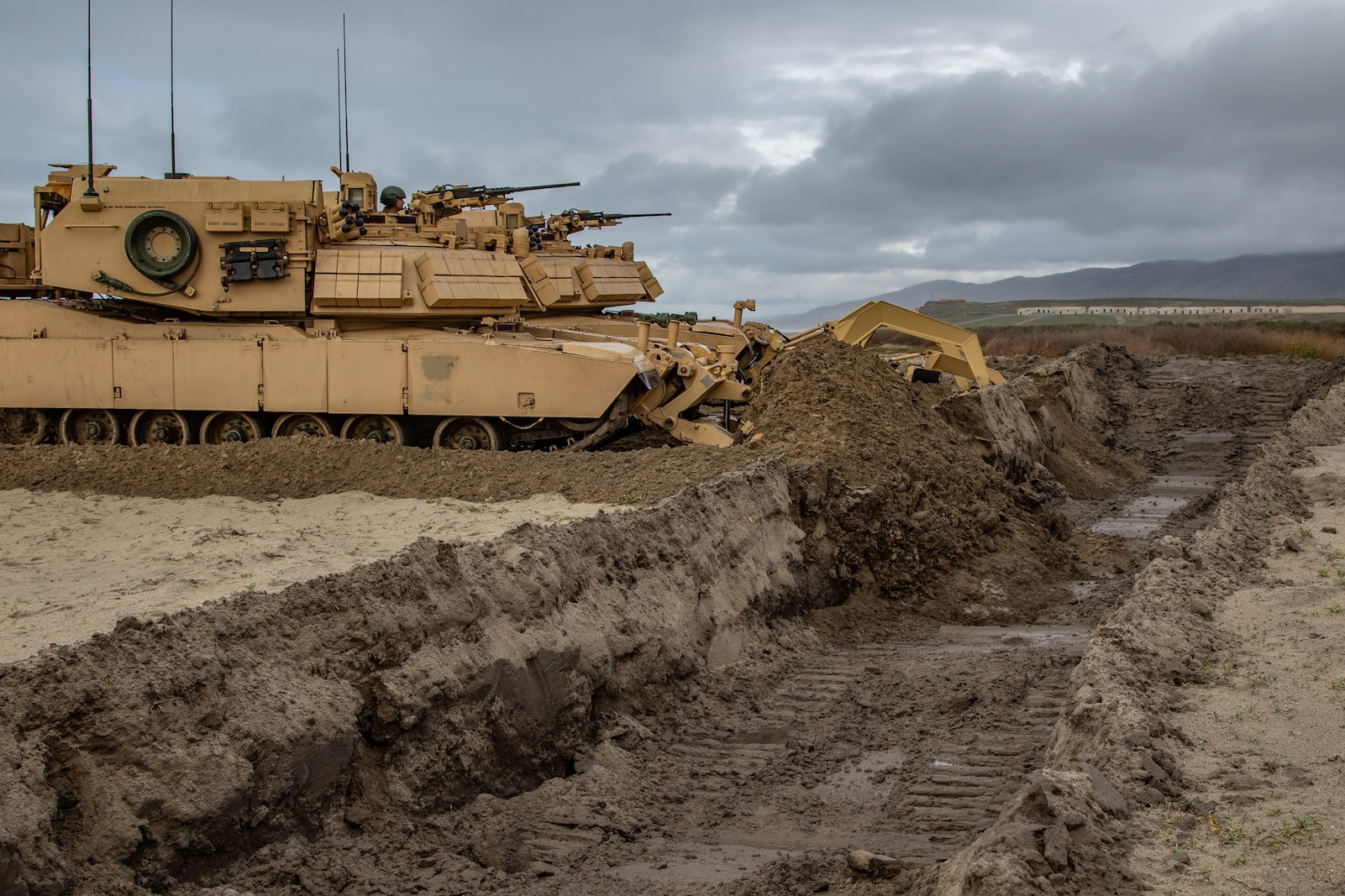 A U.S. Marine Corps assault breacher vehicle with 1st Combat Engineer Battalion, 1st Marine Division, fills a trench during a simulated amphibious assault at Marine Corps Base Camp Pendleton, California, Jan. 12, 2019.