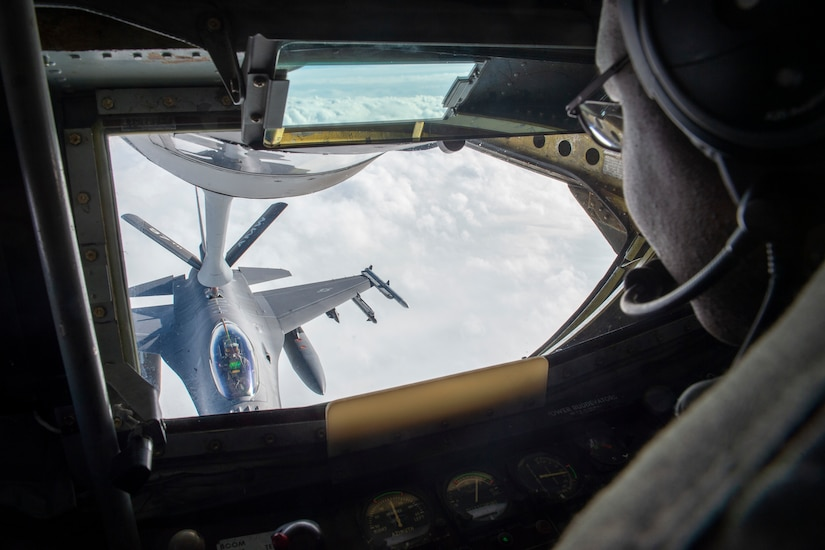 U.S. Air Force Staff Sgt. Fernando Brome, a boom operator assigned to the 54th Air Refueling Squadron, refuels an F-16 Fighting Falcon from the boom pod of a KC-135 Stratotanker, Jan. 22, 2019, Altus Air Force Base, Okla.