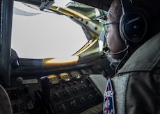 U.S. Air Force Staff Sgt. Fernando Brome, a boom operator assigned to the 54th Air Refueling Squadron, looks for another aircraft to refuel from the boom pod of a KC-135 Stratotanker, Jan. 22, 2019, at Altus Air Force Base, Okla.