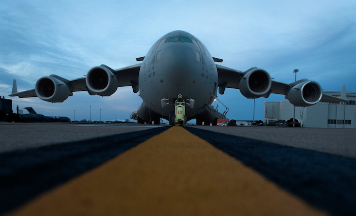 A C-17 Globemaster III gets checked to make sure it is ready to fly during the Altus Quarterly Exercise (ALTEX), Jan. 22, 2019, at Altus Air Force Base, Okla.