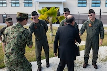 U.S. Marines with Marine Medium Tiltrotor Squadron 363 greet Japan Defense Society members during a base visit, Marine Corps Base Hawaii, Jan. 23, 2019. Members of the Japan Defense Society were given an opportunity to ask detailed questions about defense-related issues of mutual concern and regional issues. The Japan Defense Society raises citizen awareness of national defense, promote mutual understanding between the people and Self-Defense Forces to encourage sound development of the Self-Defense Forces, thus contributing to the peace and prosperity of Japan. (U.S. Marine Corps photo by Sgt. Jesus Sepulveda Torres)