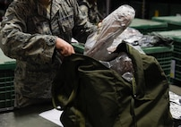 An Airman repacks his issued equipment during a pre-deployment function line exercise Jan. 23, 2019, at Joint Base Charleston, S.C.
