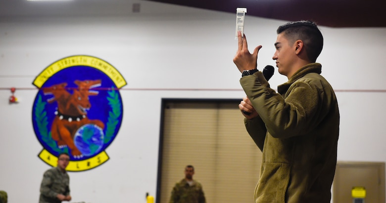Airman 1st Class Mathew McEneany, 628th Logistics Readiness Squadron supply journeyman, briefs deploying personnel during a pre-deployment function line exercise Jan. 23, 2019, at Joint Base Charleston, S.C.