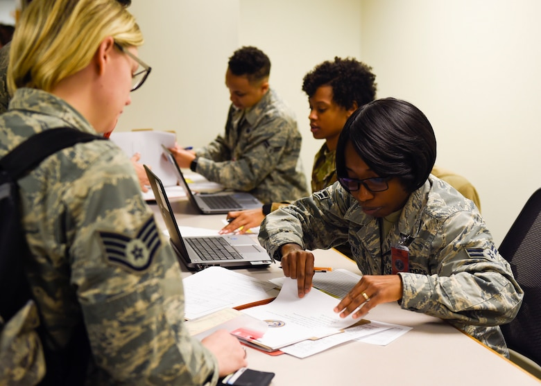 Airman 1st Class Mavis Amankwah, 628th Force Support Squadron customer support technician, assists deploying Airmen during a pre-deployment function line training Jan. 23, 2019, at Joint Base Charleston, S.C.